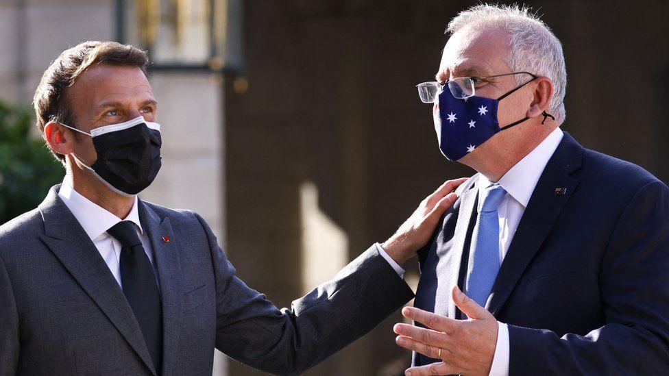 French President Emmanuel Macron claps the shoulder of Australia Prime Minister Scott Morrison at a meeting in Paris in June 2021