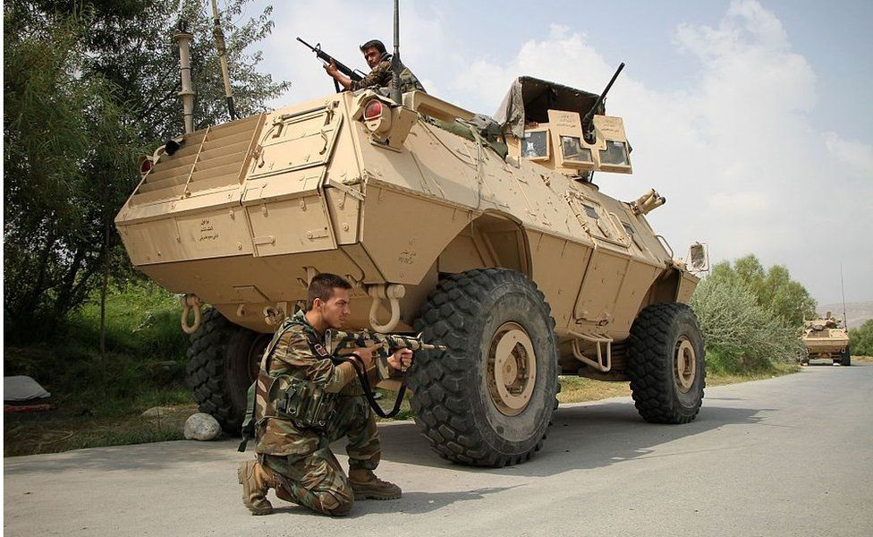 Afghan soldiers in and beside a vast armoured personnel carrier during an operation against an IS leader in Nangarhar, Afghanistan on 26 July 2016.