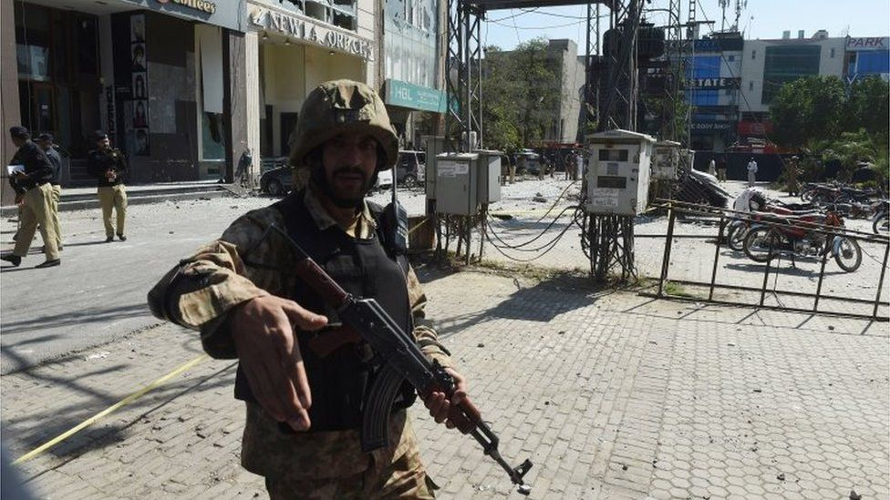 A Pakistani soldier cordons off the site of a blast in Lahore on February 23, 2017