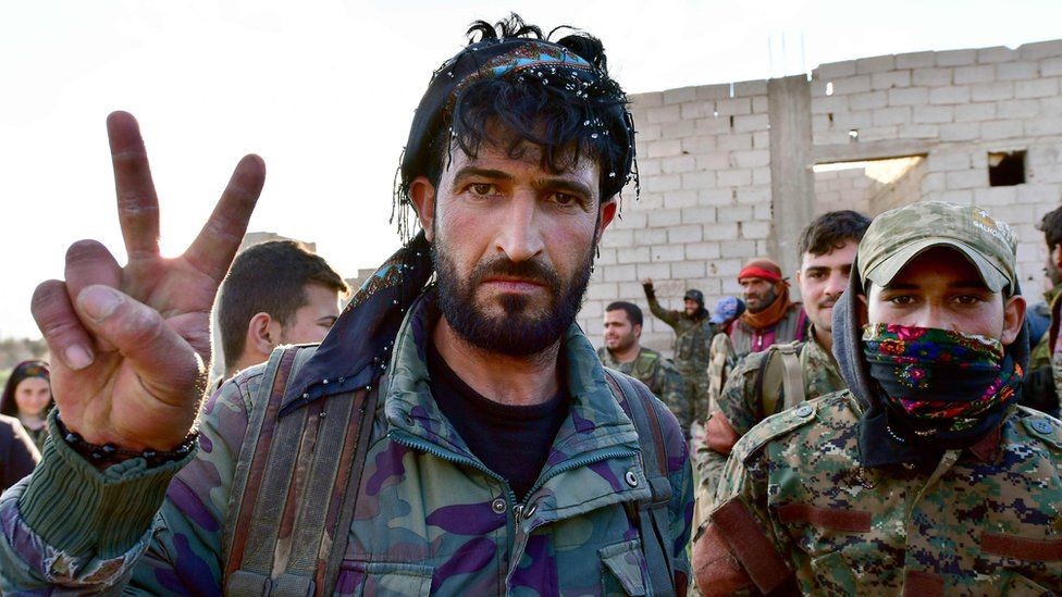 Syrian Democratic Forces fighters celebrate after returning from the front lines around Baghuz, Syria (19 March 2019)