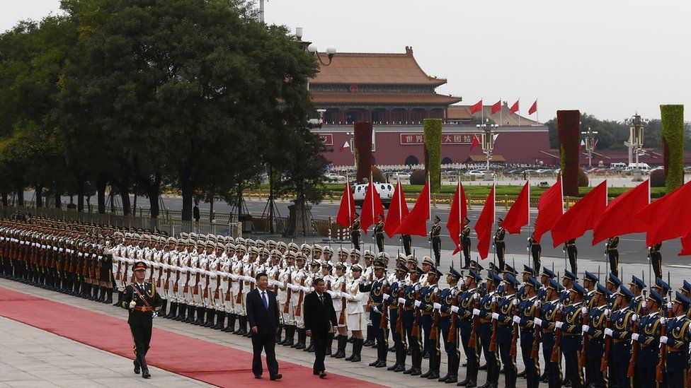 President of the Philippines Rodrigo Duterte and Chinese President Xi Jinping review the honor guard as they attend a welcoming ceremony at the Great Hall of the People on October 20, 2016