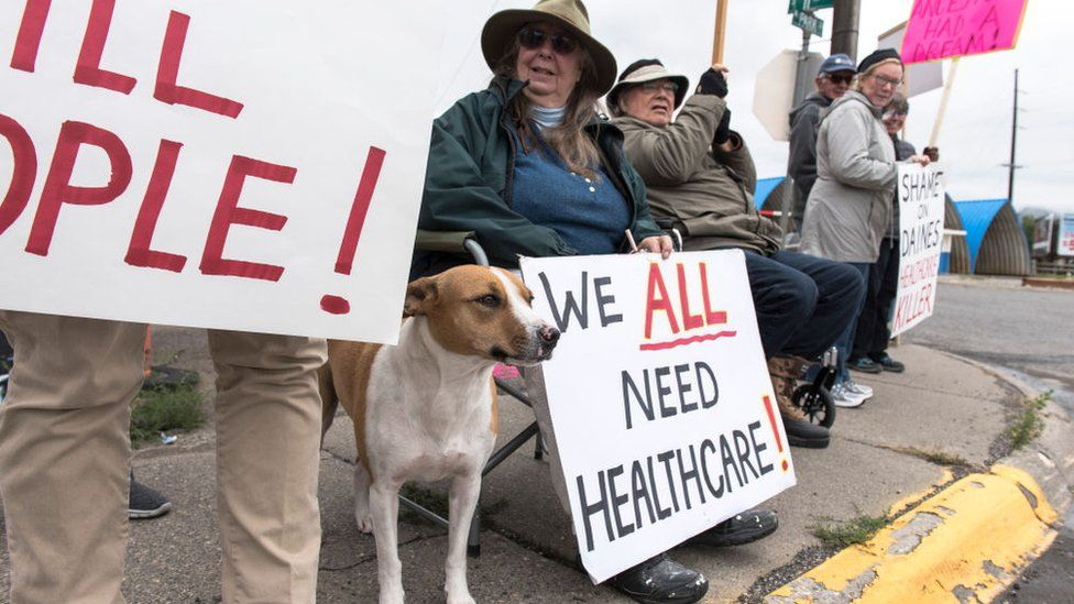 Protesters hold a small peaceful demonstration in support of health care on September 23, 2017 in Livingston, Montana