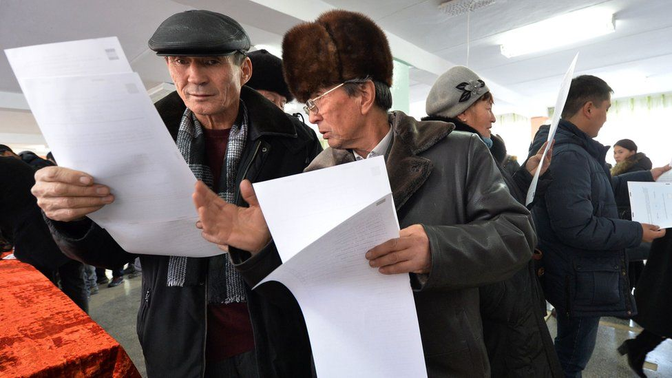 People vote at a polling station during the referendum on constitution change in the village of Baytik some 20 km from Bishkek on December 11, 2016.