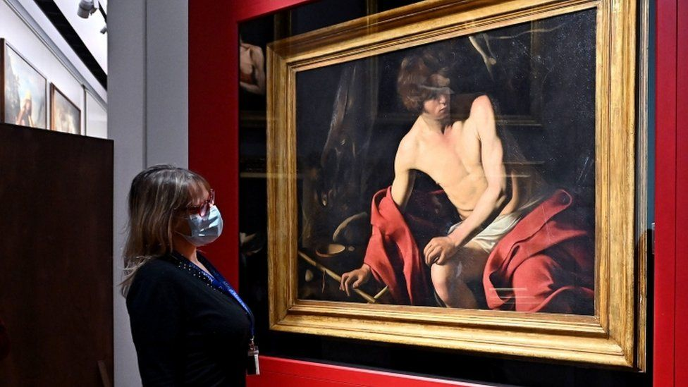 Caravaggio's San Giovanni Batista artwork on exhibit a the Royal Museums of Turin, Italy