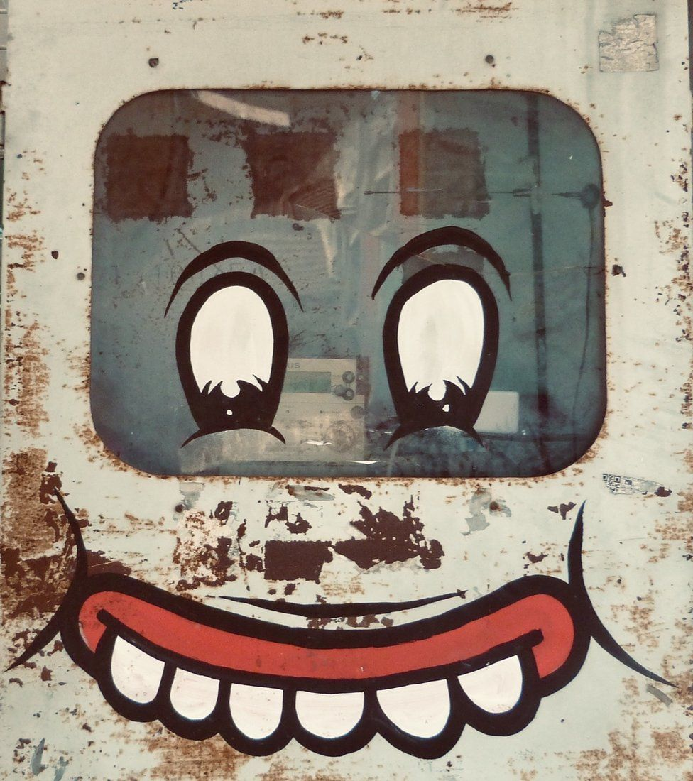 A face on an electricity box in Indonesia