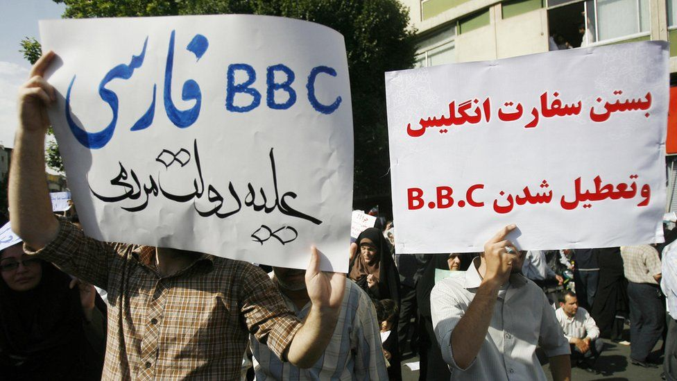 Supporters of the Iranian government protest against BBC news coverage
