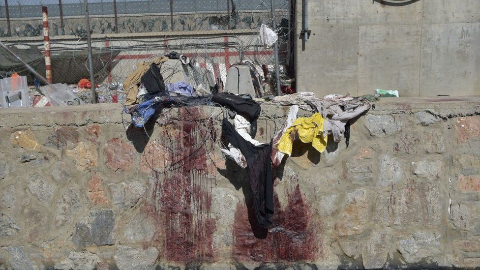 Blood-stained wall outside Kabul airport