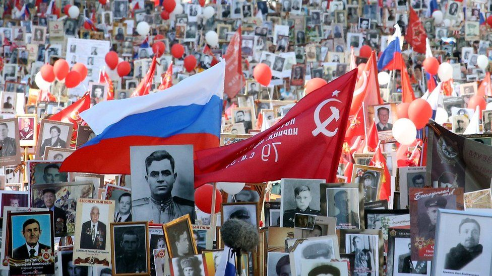 Russian people carry flags and portraits of relatives who took part in World War Two during a commemorative march titled Immortal Regiment in Moscow, Russia, 09 May 2016