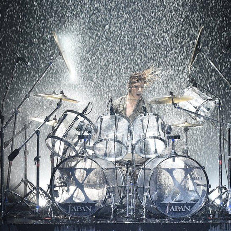Yoshiki behind his drum kit
