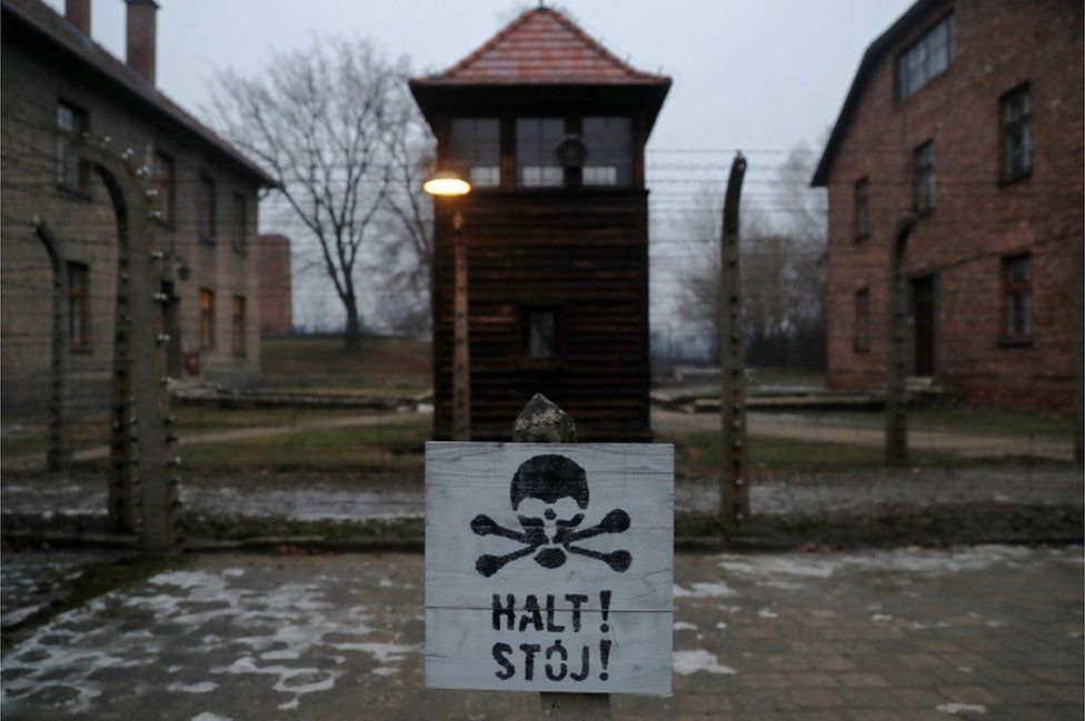 "A sign reading ""Stop!"" in German and Polish is seen at the former Nazi German concentration and extermination camp Auschwitz, 27 January 2018"
