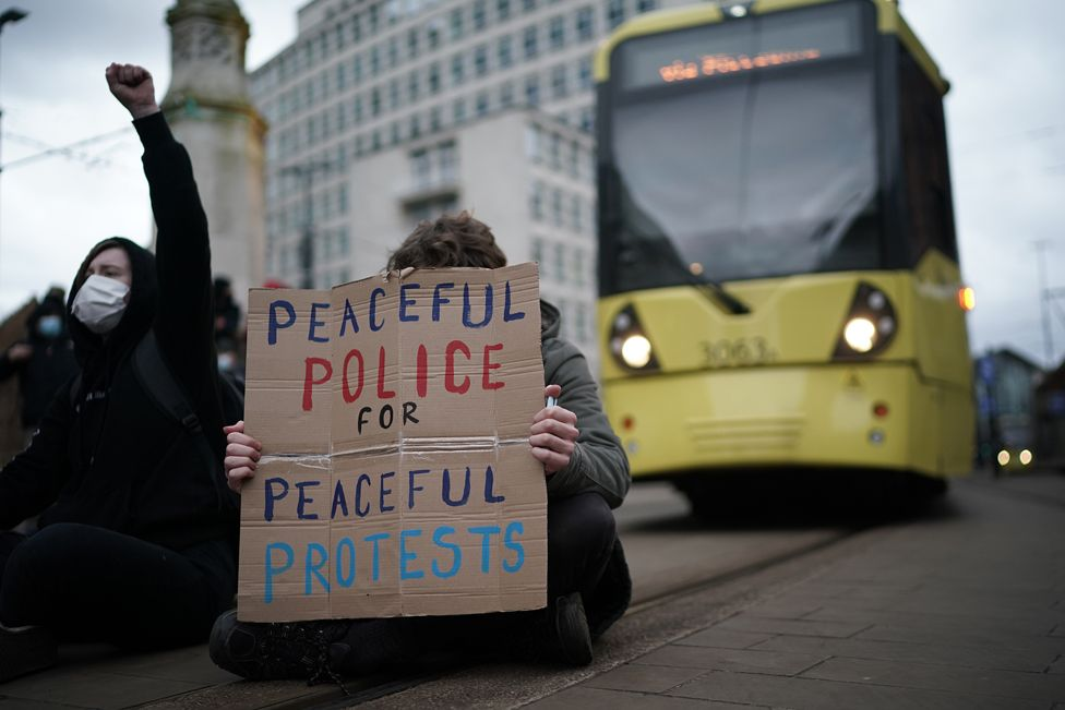 Demonstrators block the tram tracks during a Kill the Bill protest in Manchester, on 27 March 2021