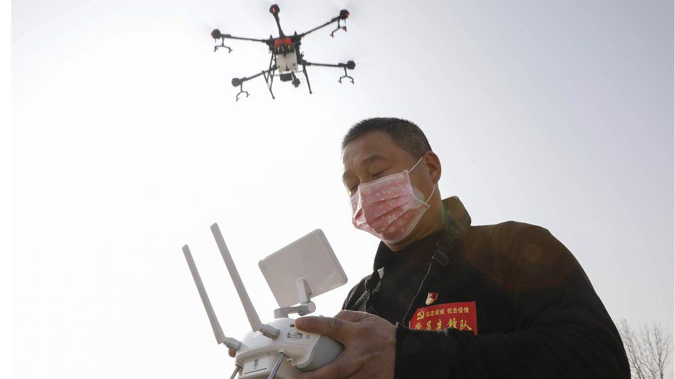 A local resident using a drone to spray disinfectant in China