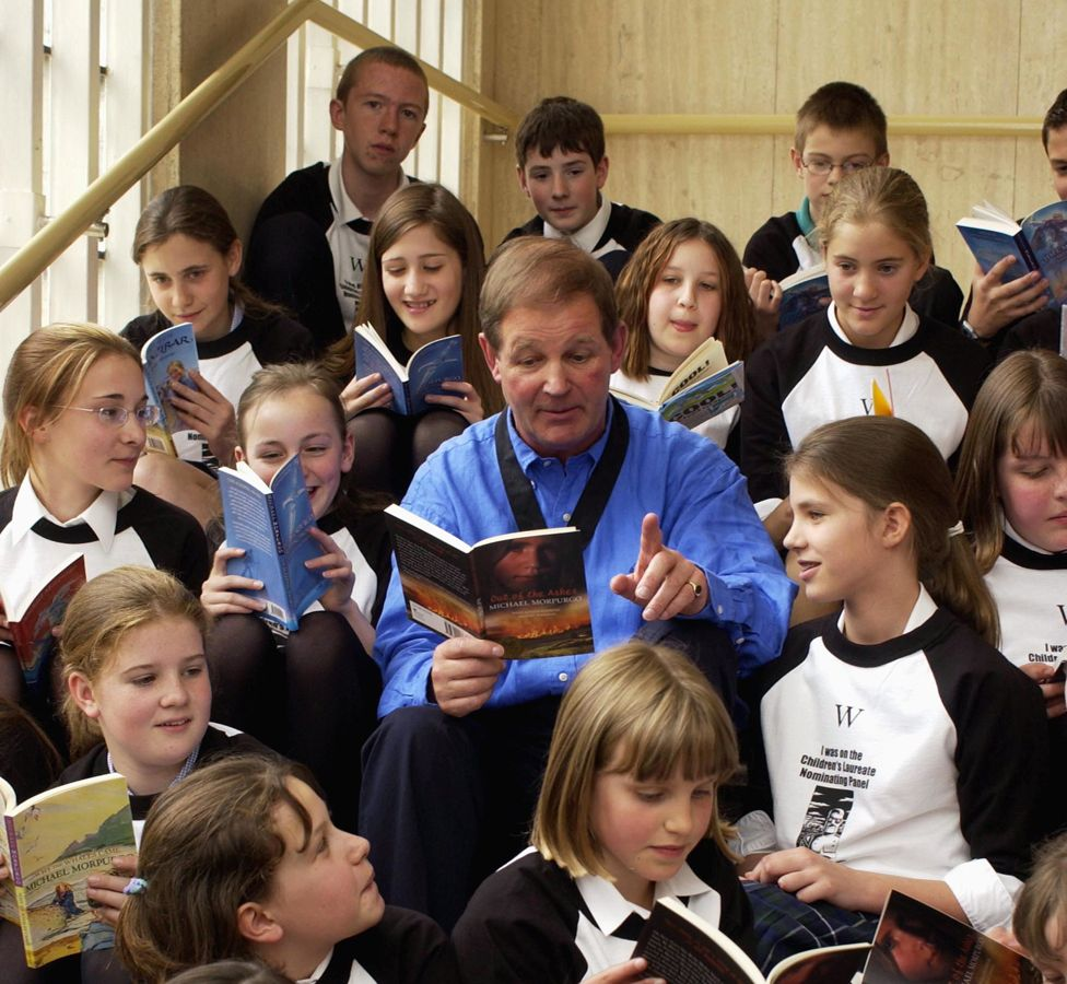 Reading to children in a book shop, in 2003