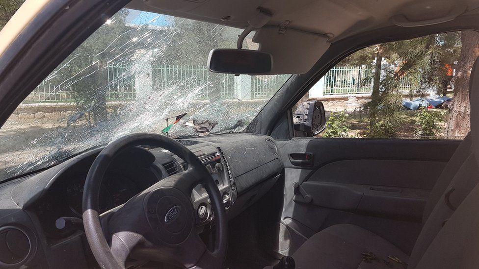 A damaged car outside the base