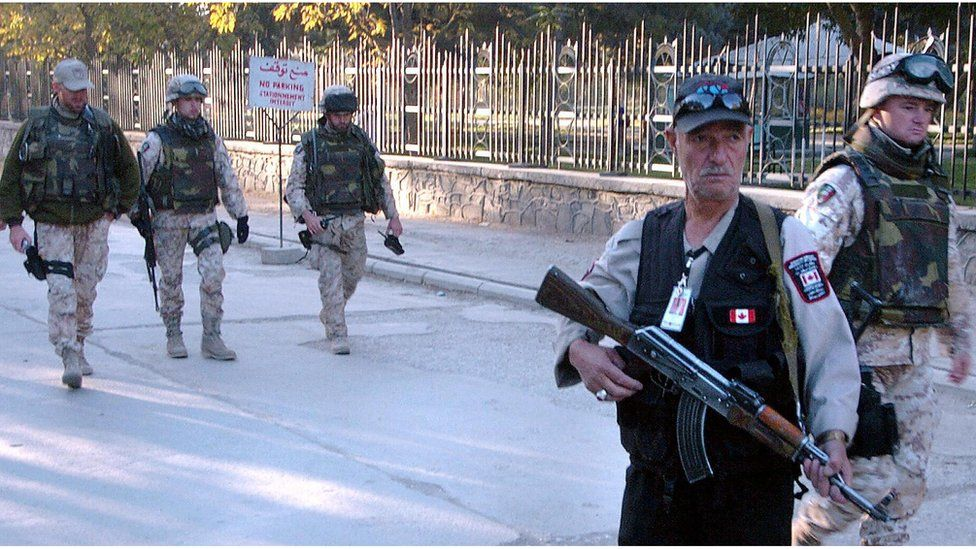 Soldiers and a security guard outside the Canadian embassy, Kabul, in 2005