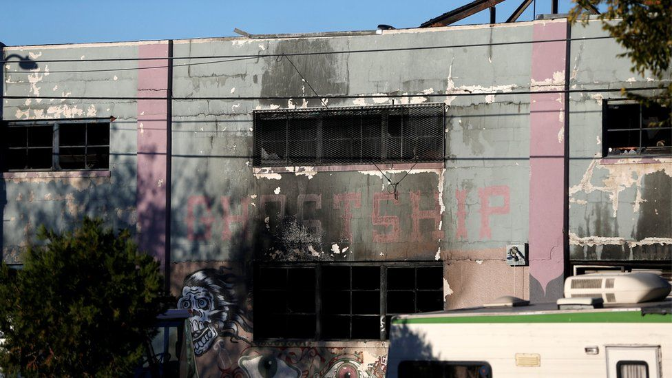 A charred wall is seen outside a warehouse after a fire broke out during an electronic dance party late Friday evening, resulting in at least nine deaths and many unaccounted for in the Fruitvale district of Oakland, California, U.S. December 3, 2016.