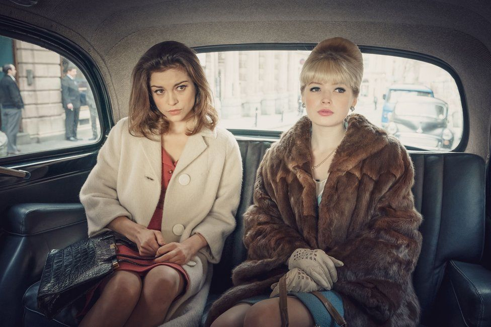 Sophie Cookson playing Christine Keeler and Ellie Bamber playing Mandy Rice-Davies