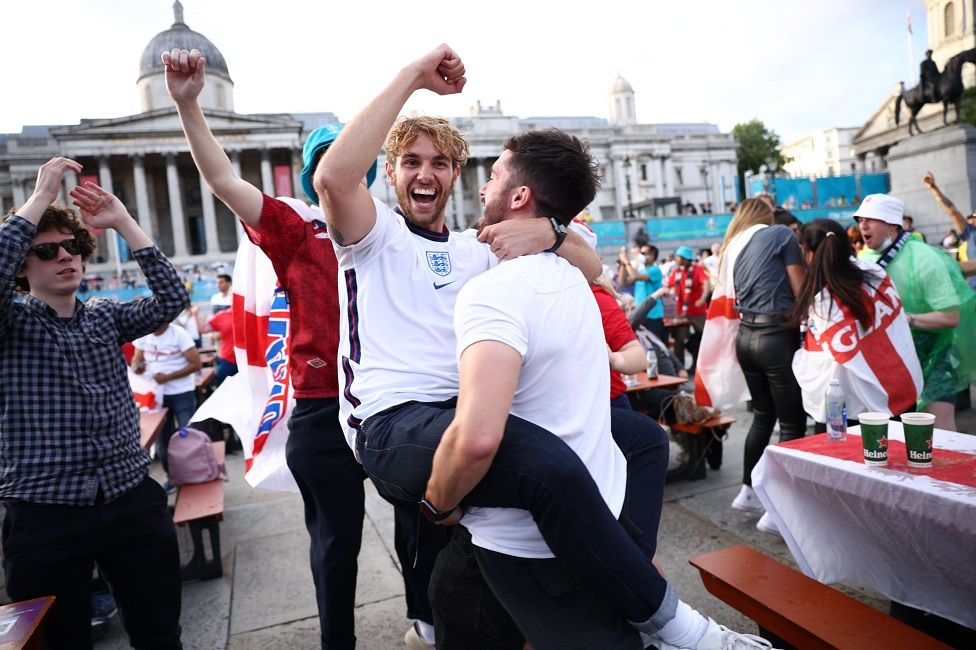 Fans gather in London ahead of Ukraine v England - London, Britain - July 3, 2021 England fans in Trafalgar Square celebrate scoring their first goal