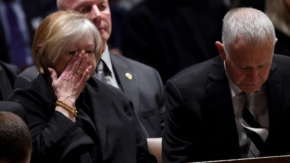 Judy and Dennis Shepard attend the interment ceremony for their son, Matthew Shepard