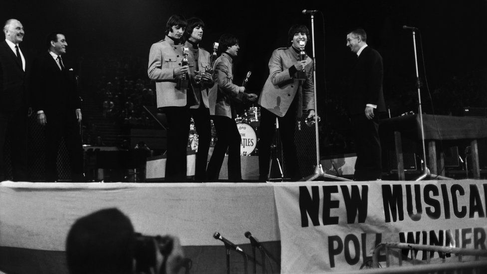 The Beatles receiving awards from Tony Bennett at the NME Poll Winners' Concert in 1965