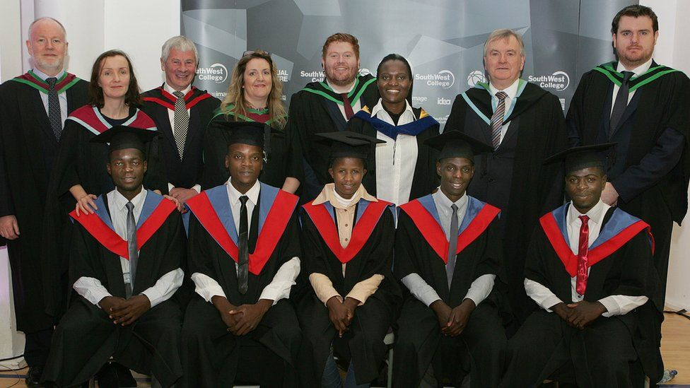Five Zambian graduates and staff from South West College