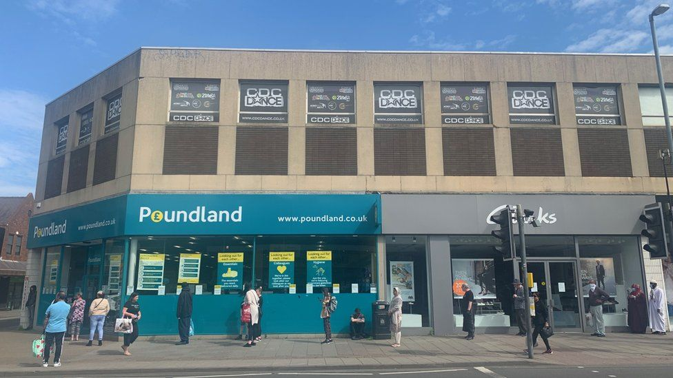 Shoppers in Kings Heath queuing for Poundland