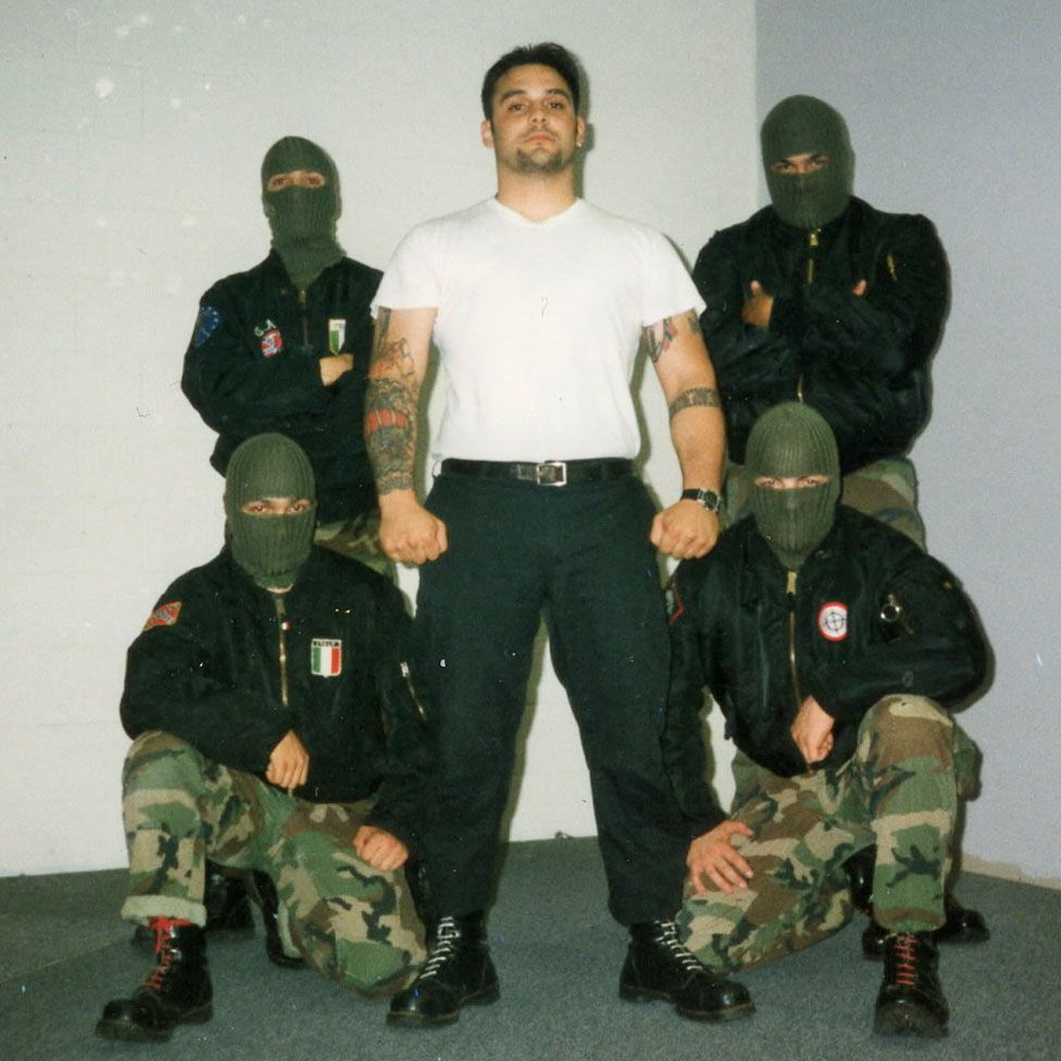 Picciolini posing with other Nazi skinheads