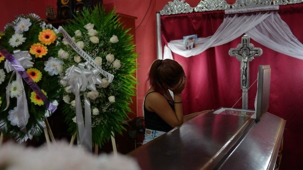 A woman looks into a coffin containing the body of the student Gerald Jose Vasquez, shot dead during clashes with riot police in a church near the National Autonomous University of Nicaragua (UNAN) in Managua,on July 15, 2018