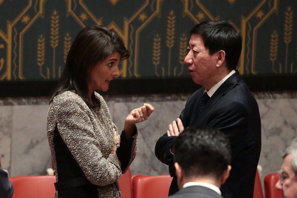 Nikki Haley (L) talks to China's Wu Haitao at the UN Security Council in New York, 29 November