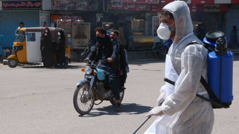Afghan worker sprays disinfectants at public areas in Herat, Afghanistan, 01 April 2020