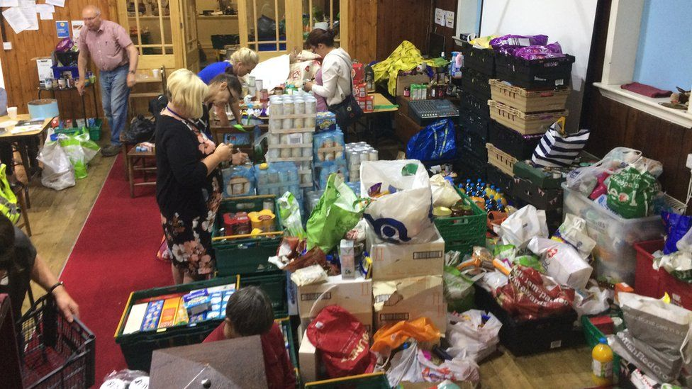 Volunteers sort through the supplies donated to Eastside Food Bank