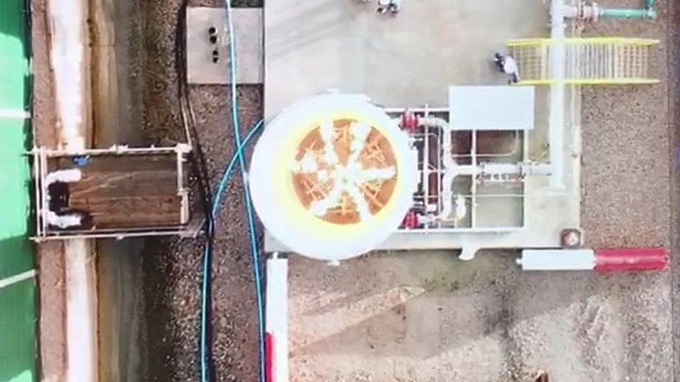 aerial view of gas setting flames alight at the well