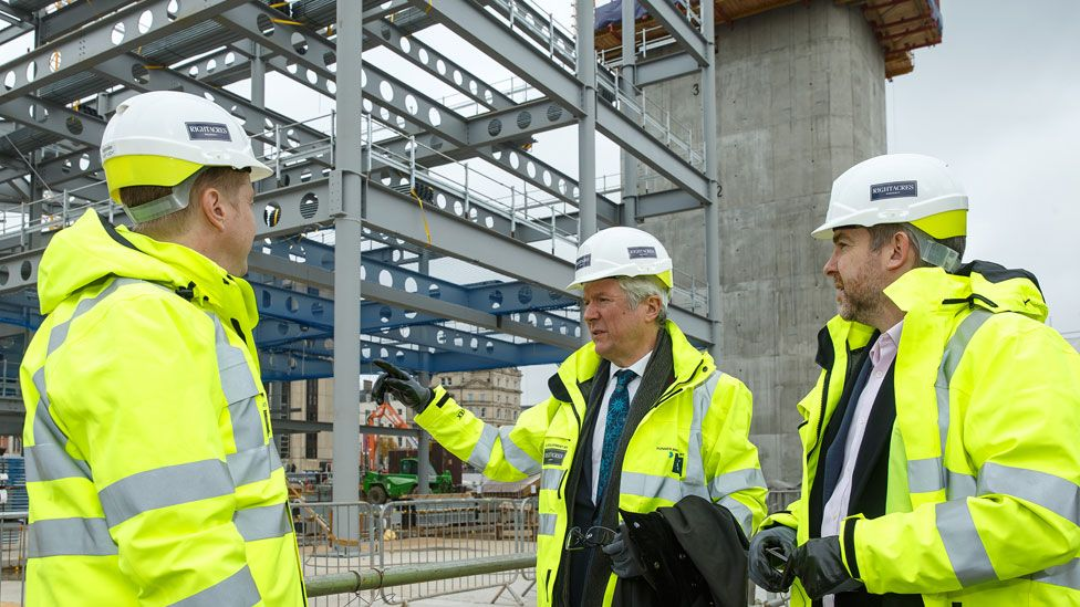 Lord Hall (centre) with Cardiff Council leader Phil Bale (left) and BBC Wales director Rhodri Talfan Davies on a visit to the new BBC Wales HQ building site in Cardiff city centre on Tuesday