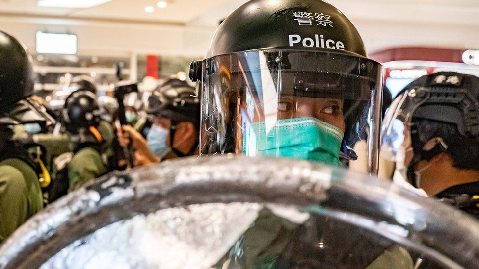 Riot police secure an area inside a shopping mall during a rally on July 21, 2020 in Hong Kong, China