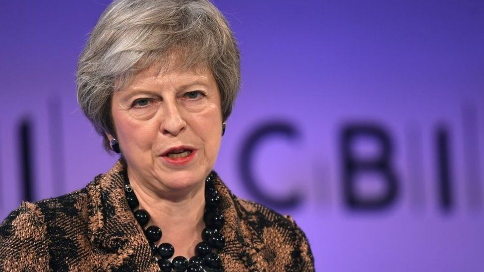 Theresa May speaking at the CBI conference