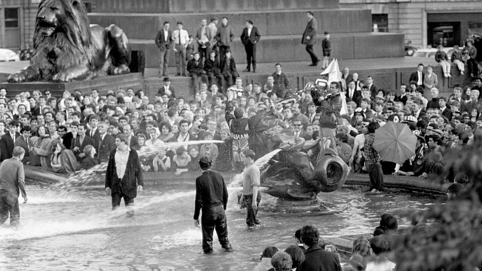 England fans celebrate winning the World Cup in the fountains at Trafalgar Square, London