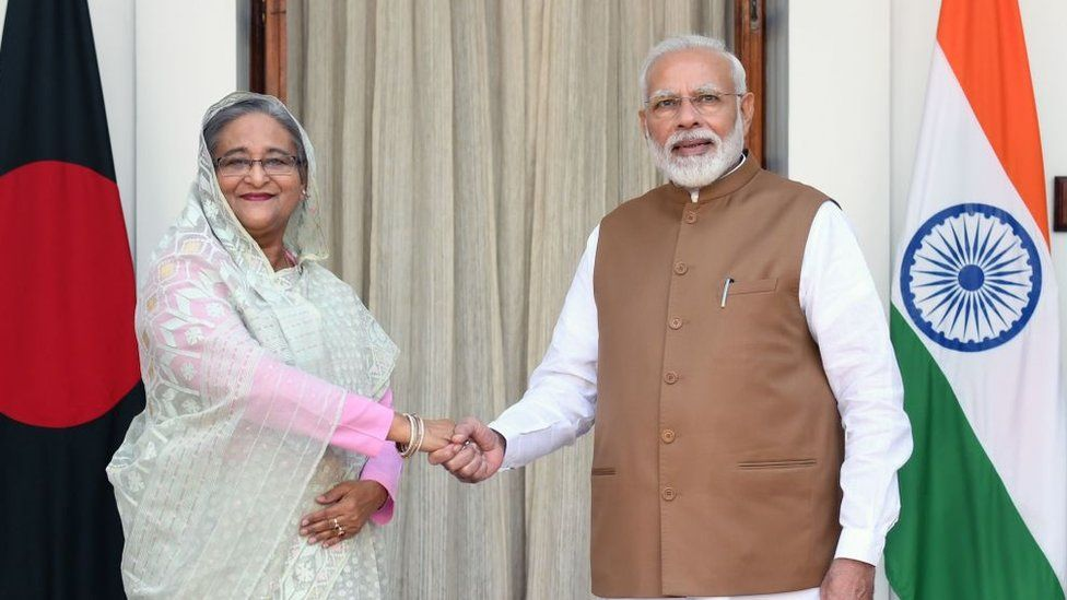 India's Prime Minister Narendra Modi (R) shakes hands with Bangladesh's Prime Minister Sheikh Hasina prior to a meeting in New Delhi on October 5, 2019