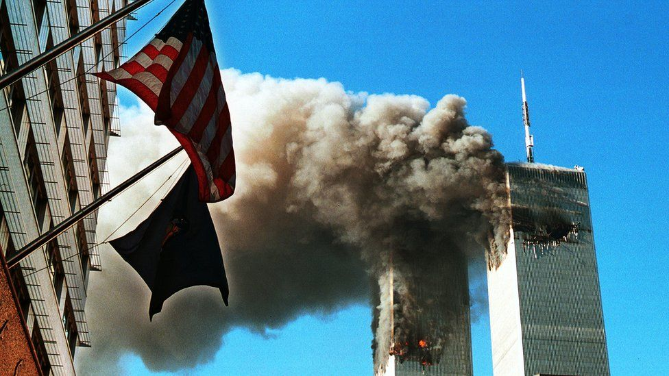 Smoke pours from the World Trade Center towers after they were hit by two planes on September 11, 2001