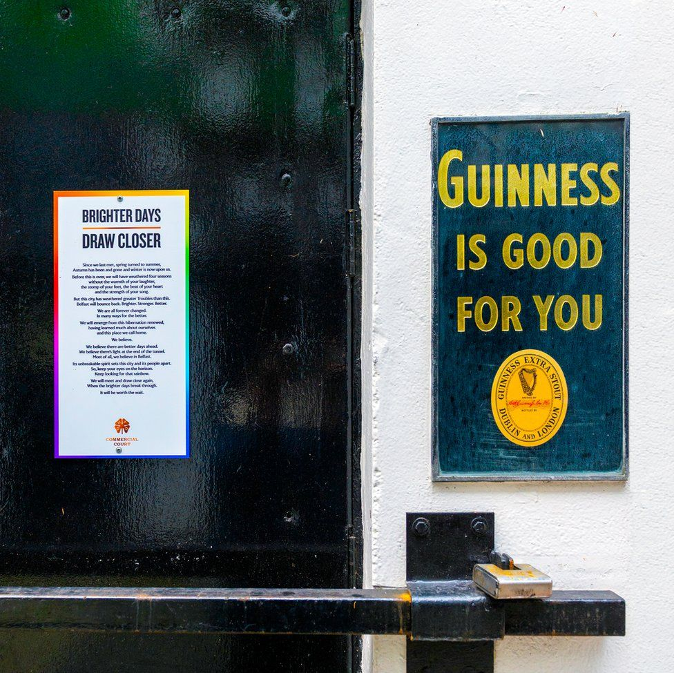 An image of a closed door next to a Guinness sign
