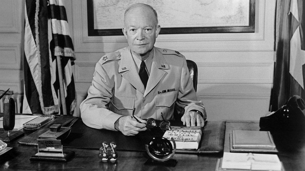 """The former Commander in chief of the Allied forces in Europe (1943) and the future US President General Dwight David """"Ike"""" Eisenhower (1890-1969) poses for a photographer in 1951 at NATO Paris headquarters"""