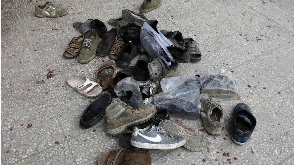 Shoes of worshippers outside a mosque in Kabul hit by a suicide bomber, 21 November 2016