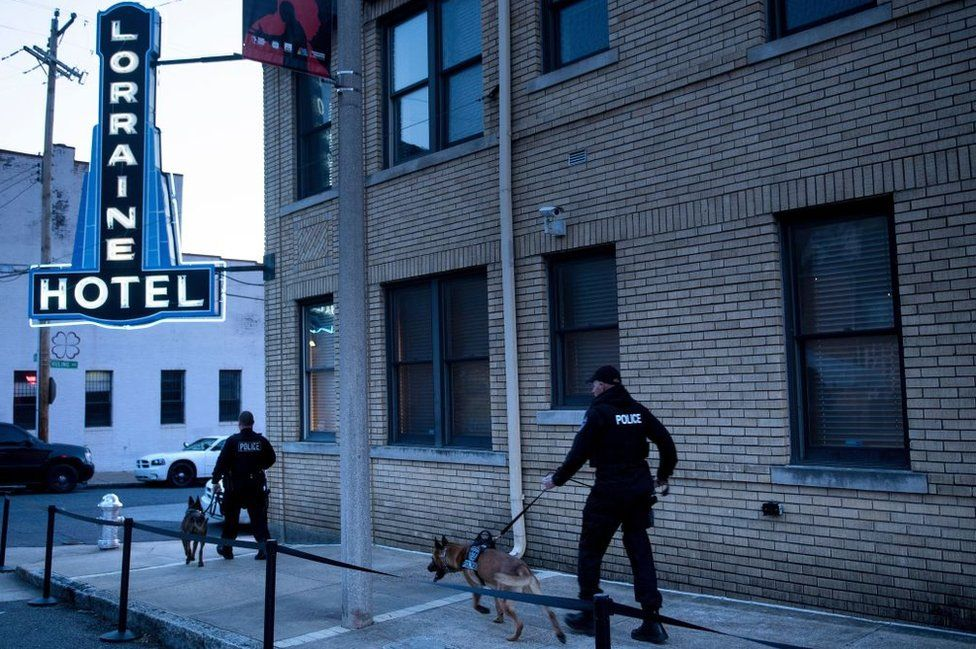 Police sniffer dogs on Wednesday morning patrol the motel where King was killed
