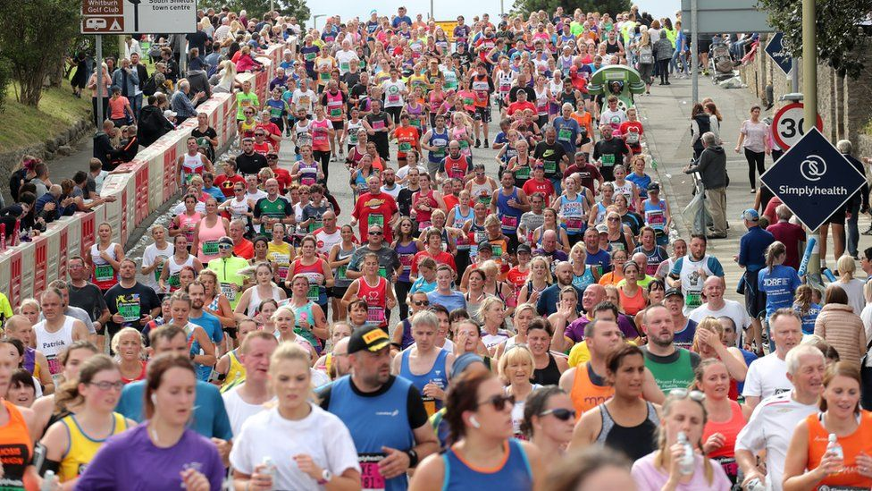 Thousands of runners make their way towards South Shields