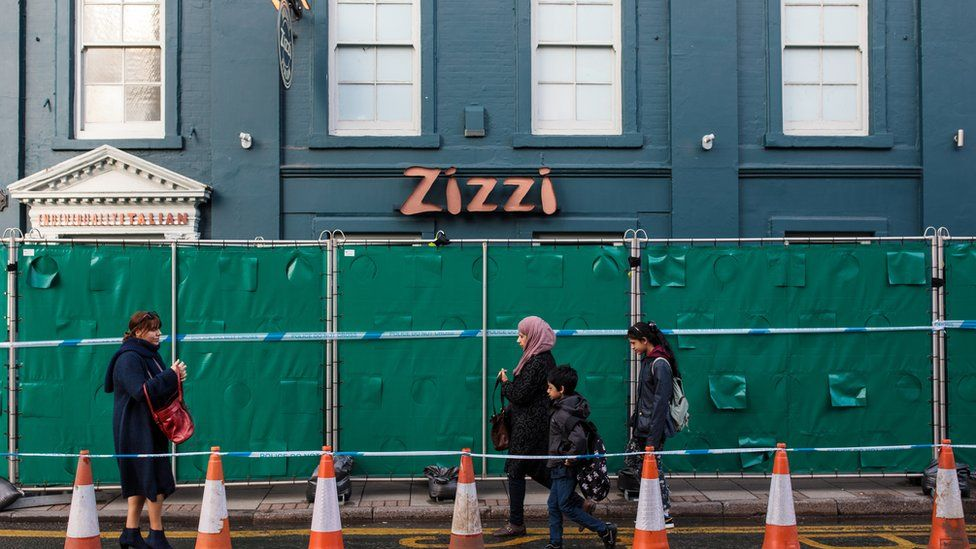 People walk past a Zizzi restaurant which has been closed as investigations continue into the poisoning of Sergei Skripal