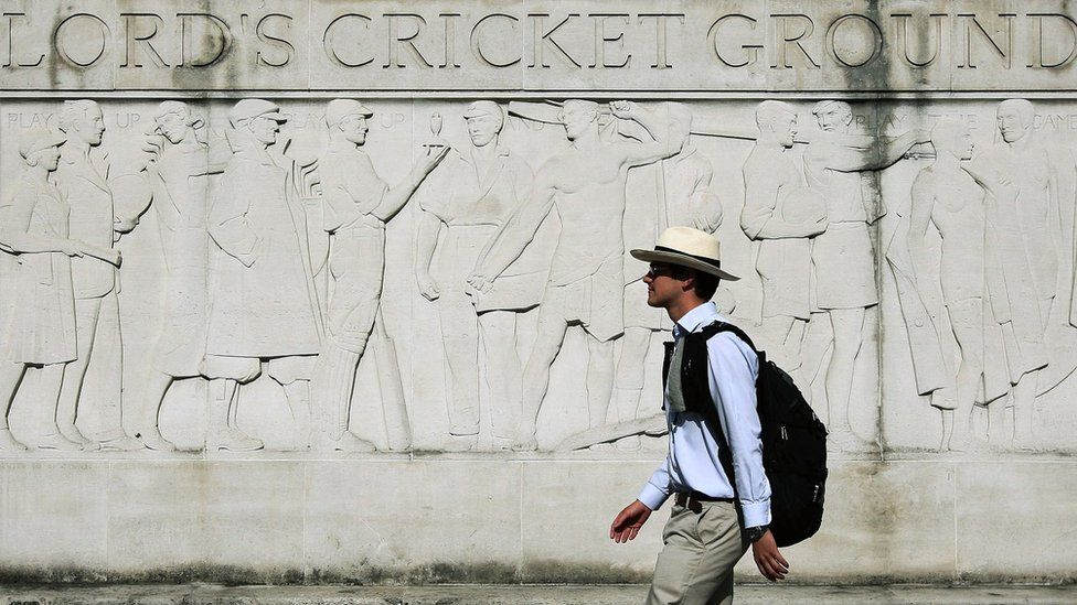 Man walks past Lord's Cricket Ground