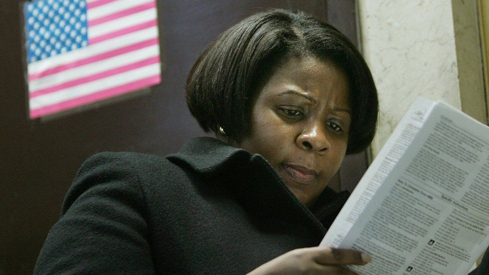 T. McKnight looks over forms as she prepares to file for a tax extension inside the James A. Farley post office building in the early evening April 17, 2007 in New York City.