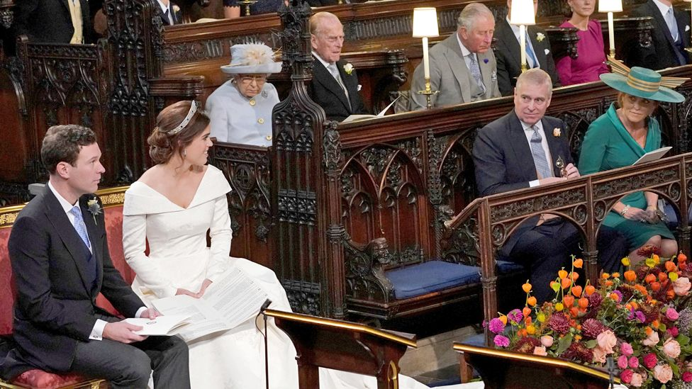 Princess Eugenie and Jack Brooksbank glance across the chapel at the Duke and Duchess of York