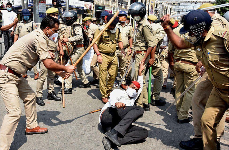 Police in Uttar Pradesh attack an opposition activist protesting against the Hathras rape case