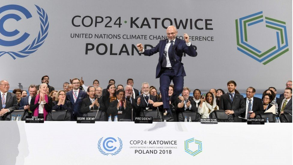 COP24 President Michal Kurtyka celebrates at the end of the COP24 UN Climate Change Conference 2018 in Katowice, Poland