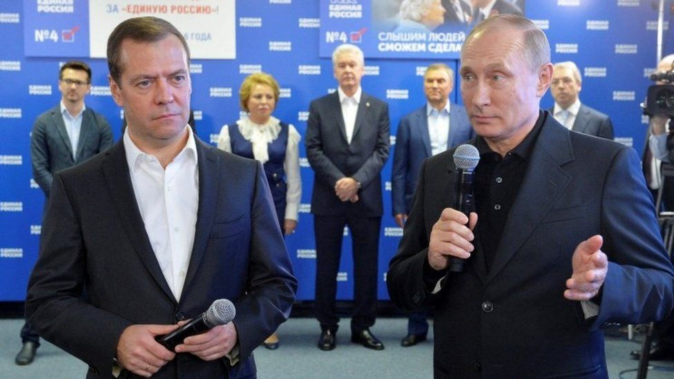 Dmitry Medvedev (L) and Vladimir Putin